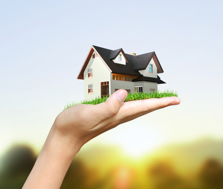 hands holding house: House model  concept in the hand Stock Photo