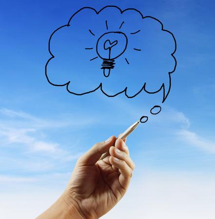 creative writing: Young businessman drawing light bulb