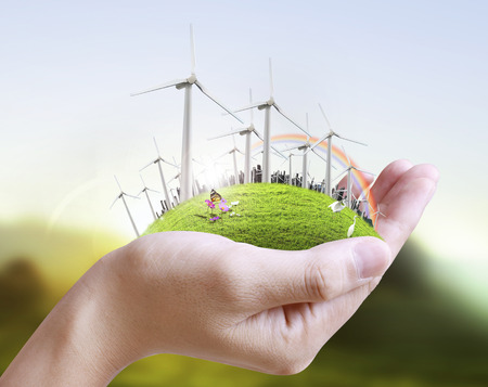 power in nature turbine: Wind turbine in a man hand  Stock Photo