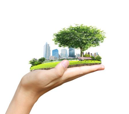 menselijke hand met de stad Stockfoto