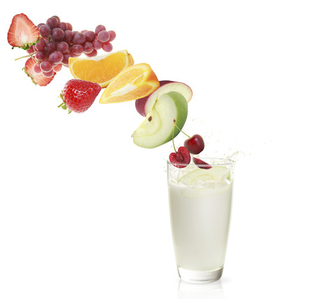 mix fruit: various type of fruit slices stacked with a splash