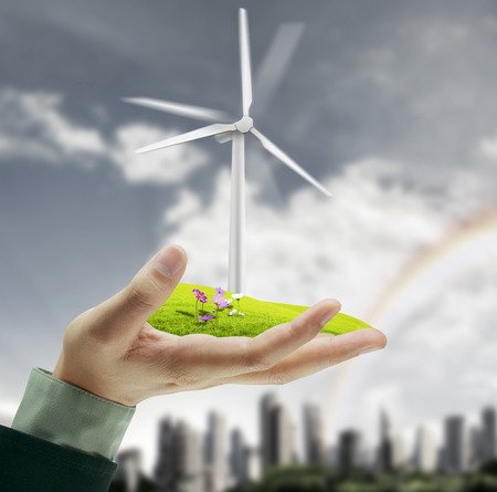 Wind turbine in a man hand photo