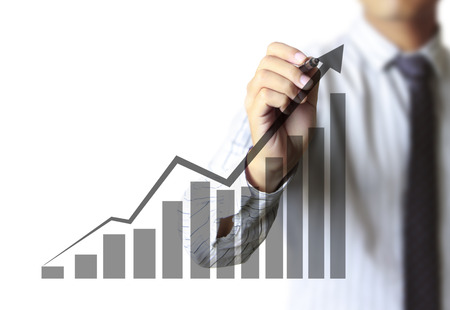 future growth: Business man hand drawing a graph