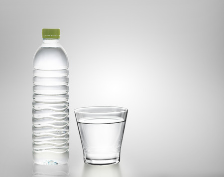 quench: Bottle of water with glass on white background  Stock Photo