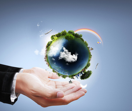 hands holding earth: holding a glowing earth globe in his hands globe in his hand. Stock Photo