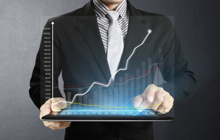 tablet computer isolated in a hand on,show graph