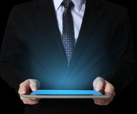 business team using tablet computer to work with financial data  photo