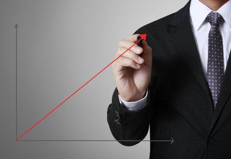 concept business man writing over target graph photo