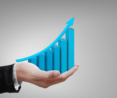 to raise: Business hands holding colorful  graph Stock Photo