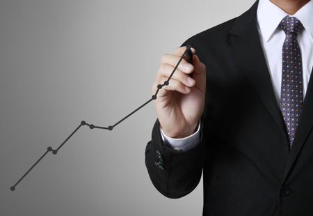 financial analysis: concept business man writing over target graph