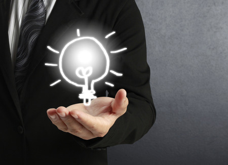 intellectual property: Hand Holding a Light Stock Photo