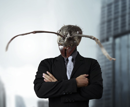 bad economy: Businessman with a ants head instead of his human head