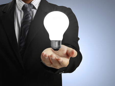 way of thinking: Hand Holding a Light Stock Photo