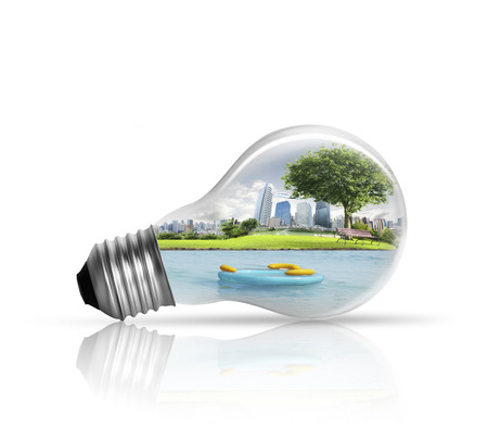 Electric light bulb and  green energy city photo