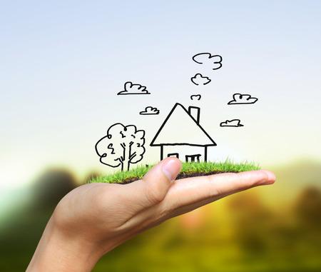 Real estate idea, holding house photo