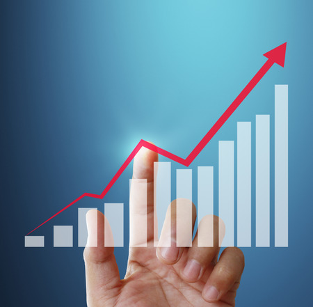 financial graph: Touch Screen financial symbols coming from hand Stock Photo