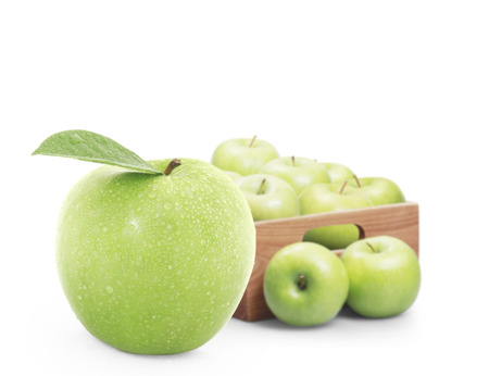 Ripe green apples with wood box photo