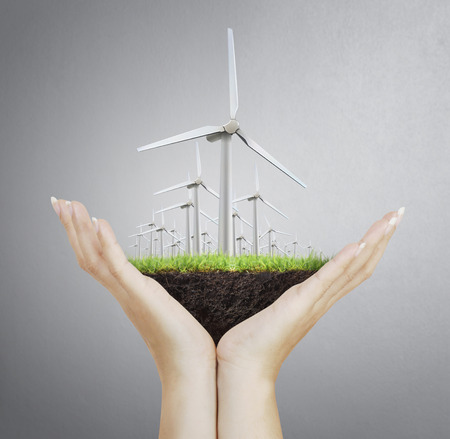 Eco power, wind turbines  in the hand photo