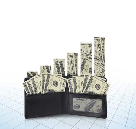 financially: dollars in bills spilling out of a billfold Stock Photo