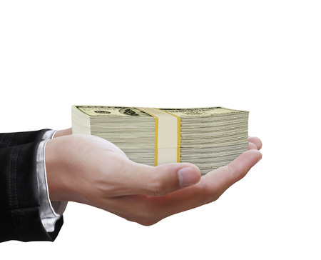paying money: Big money in the hand from business Stock Photo