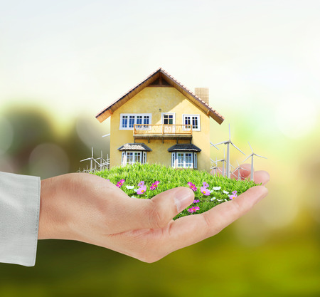 selling house: House model concept in the hand