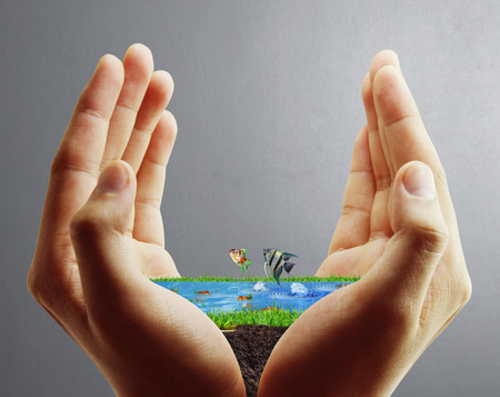 global village: Human hand holding the sea