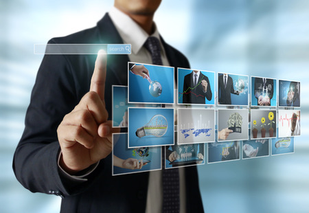 touch screen computer: businessmen and Reaching images streaming, digital photo album