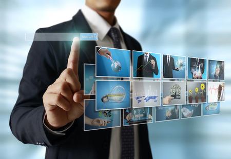 dotykový displej: podnikatelé a šátrá obrazy, digitální foto album