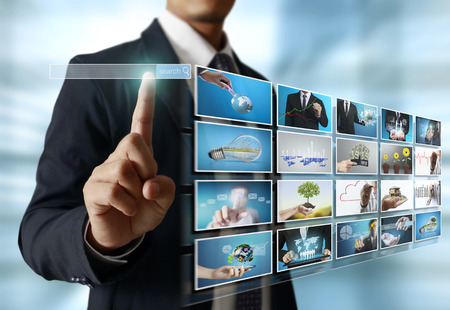 digital television: businessmen and Reaching images streaming, digital photo album