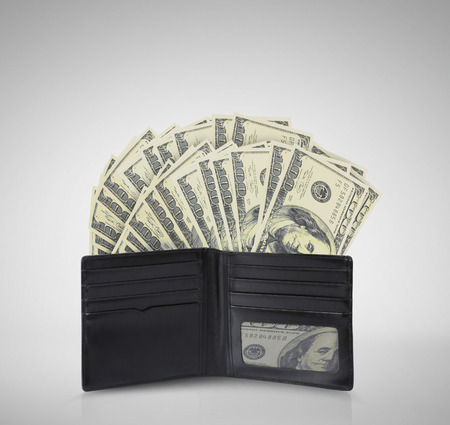 billfold: dollars in bills spilling out of a billfold Stock Photo