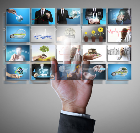 Businessman touch screen to choose digital photos photo