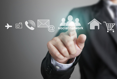 Hand pushing social network structure, new technology Foto de archivo
