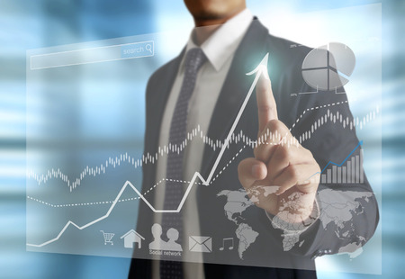 financial world: Businessman with financial symbols coming Stock Photo