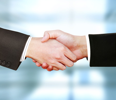 the business men shaking hands Stock Photo