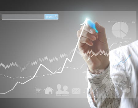software solution: businessman hand writing a business graph Stock Photo