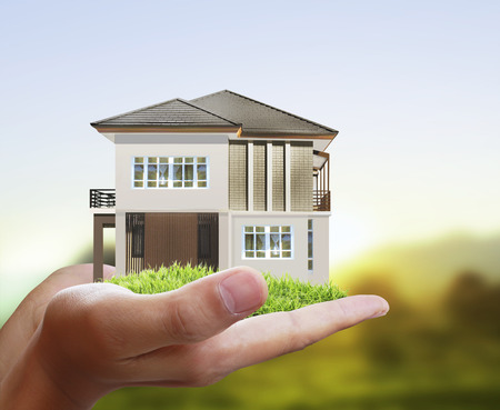 hands holding house: House model concept in the hand
