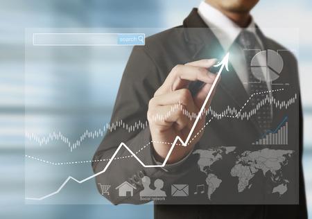 mundo manos: hombre de negocios escribir un gr�fico de negocios mano