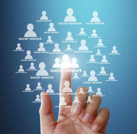 hightech: Hand pushing social network structure Stock Photo