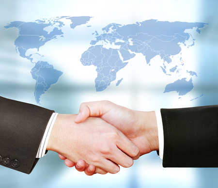 two people only: businessmen shaking hands