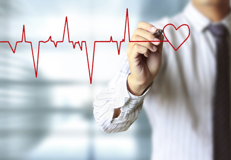 health care decisions: man drawing heart and chart heartbeat