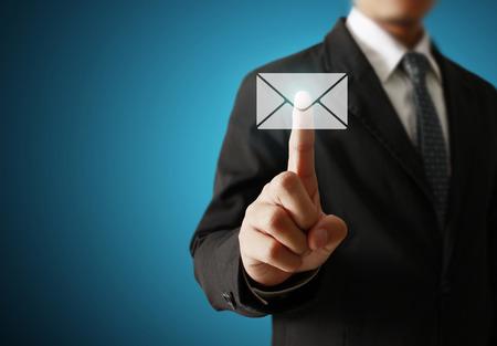 Businessman pressing virtual icons, technology concept photo