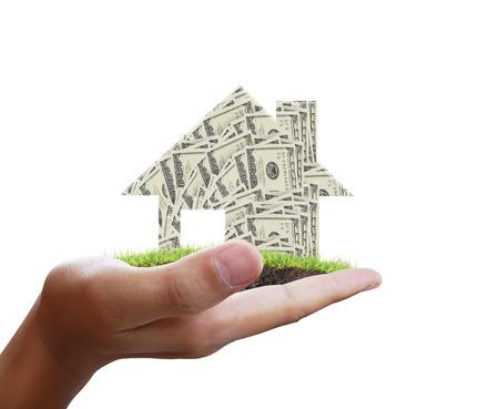 smilie: Businessman holding a house