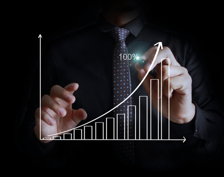 grows: Businessman drawing graphics a growing graph