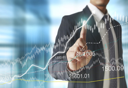 financial symbols: businessman with financial symbols coming from han