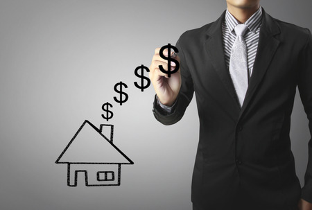 home finances: Businessman drawing a house Stock Photo