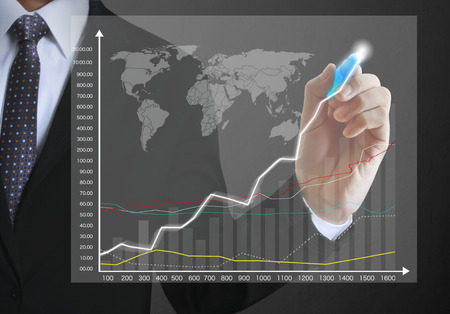 financial symbol: Businessman drawing graphics a growing graph