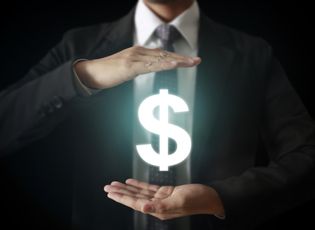 wealth management: businessman with financial symbols coming from han