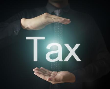 tax refund: tax refund button on virtual screen in hand
