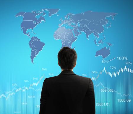 financial symbols: usinessman with financial symbols coming