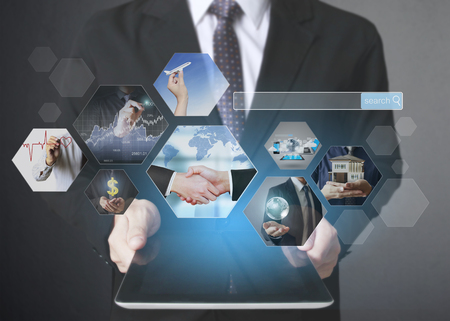 touch screen: touch screen ,touch- tablet in hands Stock Photo